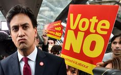 Labour Party leader Ed Miliband addresses the public and the media as he walks…