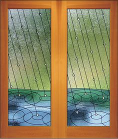 Rainfall Double Door    Innovative stained glass panel with clear textured glass and faceted jewels for rain drops. Also makes for a great window.    A best seller! Available as a pair or singularly, pick a side!