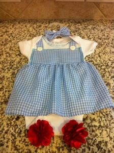 My cousin loves The Wizard of Oz and was expecting a girl. I couldn't find a Dorothy onesie dress so I decided to make one instead. Here are the supplies I used to make it I used the f… halloween nails, addams costume halloween, kesha costume halloween Cute Baby Girl Costumes, Diy Baby Costumes, Baby Girl Halloween Costumes, Costume Ideas, Kid Halloween, Costumes Kids, Halloween 2015, Halloween Nails, Halloween Crafts