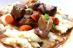 Julia Child's Boeuf Bourguignon-a beef stew over mashed potatoes. Talk about comfort food.