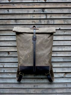 Waxed canvas rucksack/backpack with roll up top and waxed leather shoulderstrap,handle and leather bottem COLLECTION UNISEX