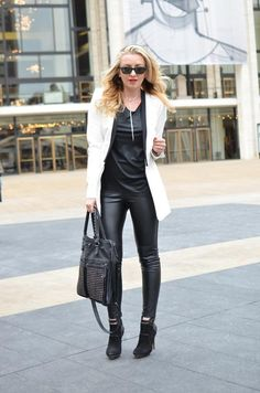 Katya looks beautiful in this contracting black and white outfit. Leather leggings, booties, and coat from BCBG, Helmut Lang top (from Spicy Candy DC)