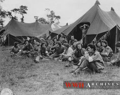 Chowtime: A group of U.S. Army nurses, first to land with the vanguard of American troops on Normandy beach heads, take time for dinner on the site of the field hospital located between the beach and the fighting up front. (6/15/1944)