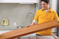 On open-top base cabinets, fill with plywood fastening strips every foot; for solid-top cabinets, create air space with thin furring strips to allow moisture to escape. Center holes in the strips and drive a screw fitted with a fender washer up through each hole, into the countertop. Find the full step-by-step here