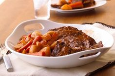 Pot Roast with Gravy    1 boneless beef pot roast (2 lb./900 g)  3/4 lb. (340 g) red potatoes (about 8), halved  8 carrots, peeled, cut into chunks  1 large onion, sliced  3/4 cup Kraft Original BBQ Sauce  3 Tbsp. flour  1/3 cup water    PLACE meat in slow cooker