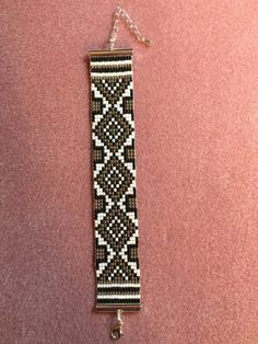 This beautiful bracelet was made on my loom with size 11 Japanese seed bead of white, silver and black. it was woven with white Nymo thread and finished with a silver clasps.  @ artfire