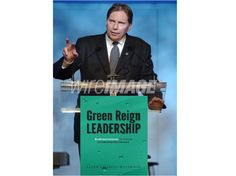 Peter Weedfald standing and delivering at the podium on Green Reign Leadership principles.