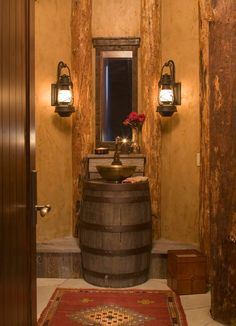 Warm Rustic Powder Room Design Ideas with Classic Mirror Style that Have Two Traditional Lanterns beside it and Unique Gold Sinks on the Wooden Barrel