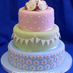 Lovely 3 tier pink, green and blue celebration wedding cake