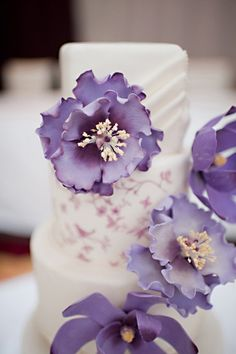 Purple flowers on white wedding cake