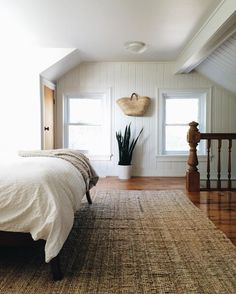 sloped bedroom ceilings with extra large rug