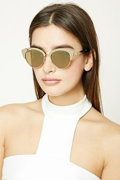 A pair of cat eye sunglasses featuring high-polish frames and mirrored lenses.