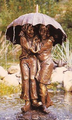 #Fountain sculpture #smile boy and girl # under the umbrella ...PUSH and choose