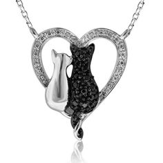 ASPCA® Tender Voices™ 1/5 CT. T.W. Enhanced Black and White Diamond Cats Pendant in Sterling Silver