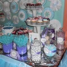 Frozen themed candy bar!  Our candy display featured lavender favor bags in varied graphic designs from The SHOP by Petite Party Studio (www.etsy.com/shop/partysuppliesbypps) and included an array of lavender, white and light blue candies from Oh Nuts! (www.ohnuts.com).  All desserts were labeled with exquisite Frozen-themed tags by Custom Event Creations (www.etsy.com/shop/CustomEventCreations) to add a touch of whimsy.