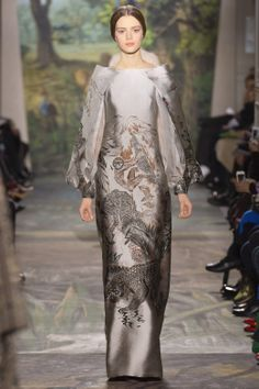 Valentino Haute Couture dress in manganese-colored brocade. Raw silk organza shirt underlaid with Chantilly lace.