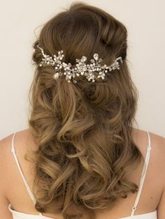 Crystal, rhinestone and pearl beaded bridal hair vine headband in a long half up bridal hairstyle by Hair Comes the Bride.
