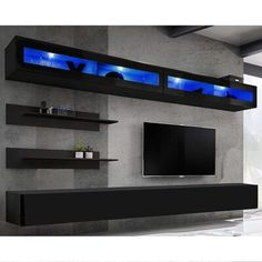 Orren Ellis This entertainment center features high gloss fronts with a matte body and LED lights system. Fronts opened by touch tip-on system and no handles necessary. It is easy to install with pins and eccentric type connections. Living Room Storage, Living Room Tv, Dream Home Design, House Design, Floating Entertainment Center, Entertainment Centers, Entertainment Shelves, Bean Bag Sofa, Game Room Design