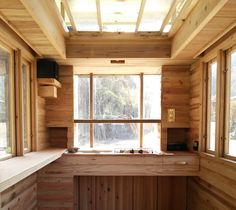 Basket - tiny house japan  ...  notice drawer on right, also drop leaf cabinets to be added under shelf on left, also curtains rolled up into boxes above windows, ... love so much of his design in this.