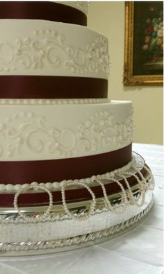 Ambrosia—I love the scroll work and pearl border on this one