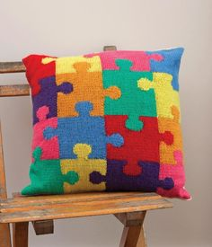 Jigsaw Cushion Cover knitting pattern by Kim Dickinson. Discover more downloadable PDF patterns at Loveknitting.