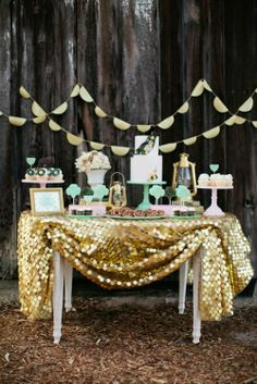 Gold sequin table cloth + teal dessert trays