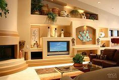 Southwest style custom home entertainment media wall with fireplace