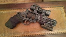 Buy Now STEAMPUNK gun, Revolver pistol ! For cosplay by IgnisFatuusBooks GBPVisit my Website for offers and exclusive items Fallout Props, Fallout Art, Sci Fi Weapons, Fantasy Weapons, Nerf Recon, Steampunk Gun, Steampunk Necklace, Steampunk Clothing, Steampunk Fashion