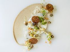 Visit the Fearrington House Inn to taste Chef Colin Bedford's creations, including this truffle dish—paired with Madeira custard and topped with wild mushrooms, potatoes, leek, and fennel—from this year's new fall tasting menu.