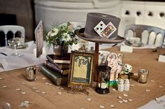 Wouldnt want the Alice in Wonderland theme, but what a fabulous collection of objects for a centre piece.   Jenny Packham and a 1970s Veil For A Mad Hatters Tea Party Inspired, Elegant London Wedding