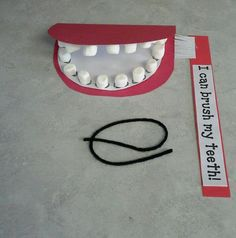 Great preschool idea: taking care of your body/teeth. Marshmallow teeth, the kids loved practicing brushing and flossing!