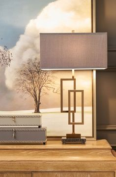 wrought iron lamp coffee bronze finish with decorative boxes in the front of the beautiful oil painting; modern lighting ideas; decorating inspiration