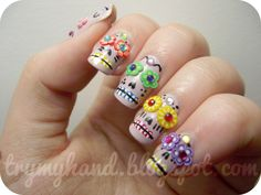 Good use of the fimo flowers! http://trymyhand.blogspot.com/2012/08/notd-dia-de-los-muertos-sugar-skulls.html