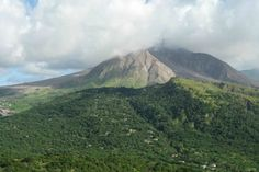 Montserrat: The Soufrière Hill Volcano which buried most of the former capital Plymouth essentially creating a modern day Pompeii. British West Indies, Emerald Isle, Pompeii, Natural Disasters, Plymouth, Adventure Travel, Caribbean, Travel Destinations, Tourism