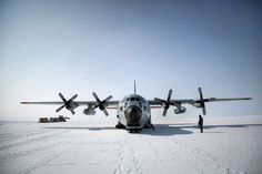 An LC-130 plane, equipped with skies, from the Air National Guard's 109th Airlift Wing at Summit Station, a remote outpost in Greenland, July 15, 2015. Summit Station is one of several Greenland sites where researchers gather data that will improve climate models and help predict climate change affecting future generations. (Josh Haner/The New York Times) ORG XMIT: XNYT49 Photo: JOSH HANER / NYTNS