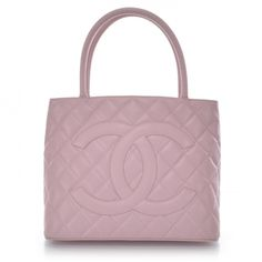 This is an authentic CHANEL Caviar Medallion Tote in Pink.   The bold features and refined quality of this Chanel tote create a classic elegance for day or evening.