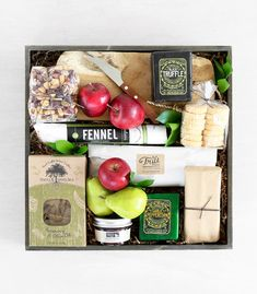 This artisanal assortment features three varieties of farmhouse cheeses, a jar of Doves and Figs jam, cranberry nut mix, and cheddar rounds from Concord Teacakesr: 'Farmhouse Cheese Crate' by Winston Flowers.