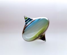 glass spinning tops | glass spinning top sculpture by katy holford that looks like