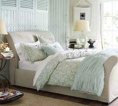 blue shutters, slipcovered bed, glass jar lamp, blue ruched bedding...I'll take it all.