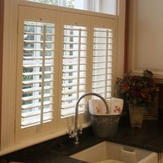 Window shutters in the kitchen. Pretty.