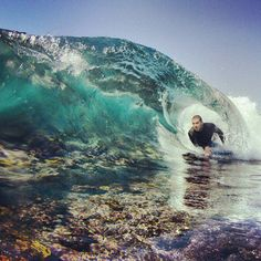 Bodyboarding a reef break.  http://www.this-is-illegal.com/