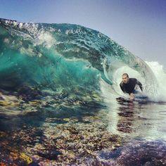 Bodyboarding a reef break.  http://www.this-is-illegal.com/