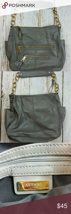 ALFANI Leather Purse ~Genuine leather ~Color is grey with gold chain accent ~2 zipper pockets on front ~2 pockets on sides of purse  ~NO TRADES  ~REASONABLE OFFERS ACCEPTED  ~PLEASE ASK ALL QUESTIONS BEFORE PURCHASING Alfani Bags Shoulder Bags
