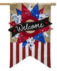 This beautifully and brightly detailed, patriotic themed, burlaphouse flag is enhanced with an abundance of embroidered and appliqued details.The wreath consists of triangular pieces of red, white a