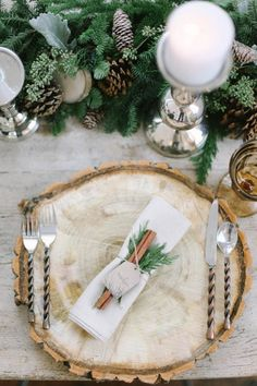 There's a lot of stark beauty in winter, and this place setting celebrates it!  Using a woodcut as a sturdy charger, a woodsy table runner of pine boughs, and cinnamon sticks tucked into napkin rings, this table is a warm welcome from the cold!