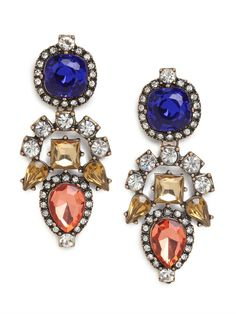 If you like your glamour with a feisty kick, then you'll fall for these gorgeous drop earrings. Subtly inspired by Aztec graphics and crafted from a treasure chest's worth of brightly colored gems, they're simply spectacular.
