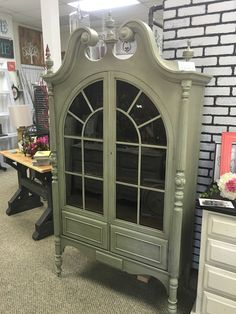 """Beautiful china cabinet painted in Sage Advice(Sage) by Country Chic Paint and antiqued. A great piece to add to any space. Measurements: 77""""Hx42""""Lx18""""W"""