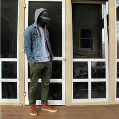 Shop this look for $112:  http://lookastic.com/men/looks/high-top-sneakers-and-chinos-and-denim-jacket-and-v-neck-t-shirt-and-hoodie-and-cap/73  — Brown High Top Sneakers  — Olive Chinos  — Blue Denim Jacket  — White V-neck T-shirt  — Grey Hoodie  — Olive Cap