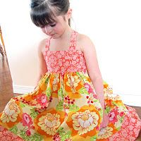 free pattern in the garden shirred twirly dress. Looks so pretty and a great pattern to try shirring with for the first time.