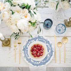 Pretty festive tablescape: http://www.stylemepretty.com/living/2015/07/02/a-sophisticated-twist-on-red-white-blue/ | Photography: Steve Steinhardt - http://www.stevesteinhardt.com/